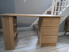 Oak wood effect desk with shelves and drawers.