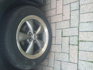 New mustang bullet rims with 2 month old tires Windsor Region Ontario image 1