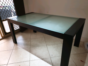 Glass top dining table in good condition