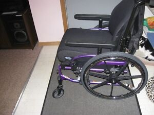 Solid back manual wheelchair