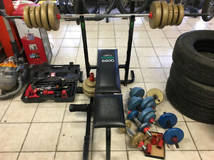 YORK 6600 with lots of waights and has leg bench