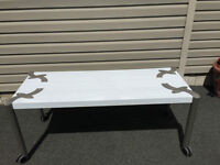 Three white Display Tables with locking wheels