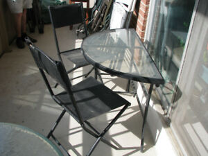 Half round bistro table and folding chairs