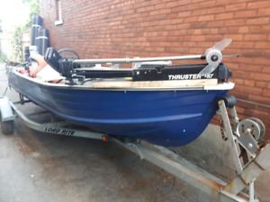 14 ft aluminum boat and 30hp motor with trailer
