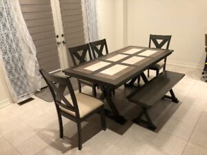 Modern day dining table with chairs and bench