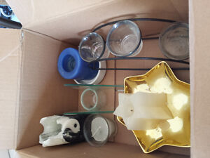 Box of candles and candles holders