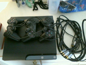 PS3, TWENTY-TWO GAMES AND THREE CONTROLLERS