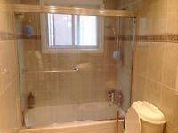 Glass sliding shower doors