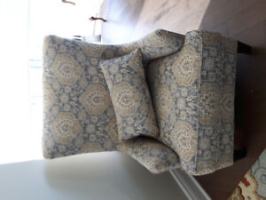Lovely blue grey love seat with accent pillows and accent chair