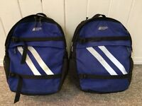 Pair of MEC 20L panniers with rain covers and rack