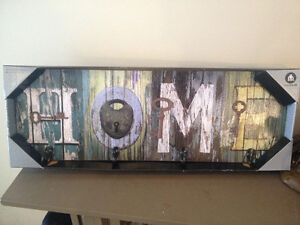 """HOME"" sign with hooks"