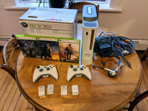 Xbox 360 with 2 controllers and 3 games