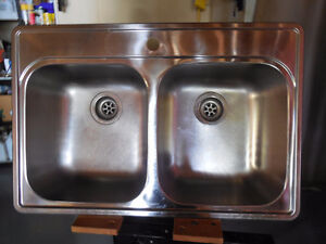 Double Stainless Sink and Moen Spray Faucet