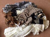 Black bag full of assorted scarves