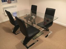 Glass dining table + 4 black chairs