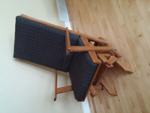 Wooden glider with cushion