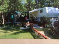 1999 25 foot fifth wheel with slide on site in gimli