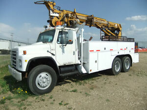 auger truck and pole truck
