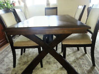 Dining table with 6 chairs paid 1200$ asking 499$