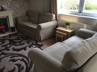 Two IKEA Erktorp two seater sofas.