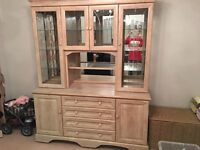 Large unit and display case with lighting in limed oak veneer.