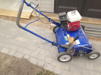 Power raking vacuuming aerating lawns AND tilling small gardens