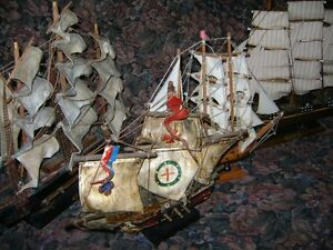 FOUR ANTIQUE WOODEN SHIPS AND LAMP