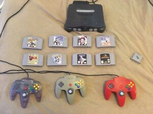 nintendo64 with 8 games , 3 controllers. London Ontario image 1