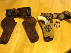 TWO ANTIQUE CHILDRENS LEATHER WESTERN GUN BELTS
