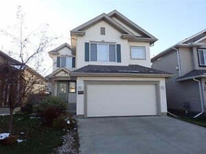 Gorgeous Bright Home in MacEwan with large deck and skylights