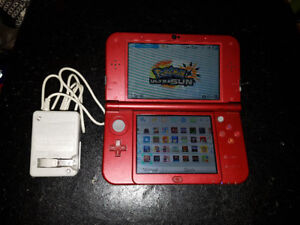 Red New Nintendo 3ds xl with tons of games