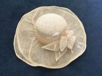 Wide brimmed cream wedding hat