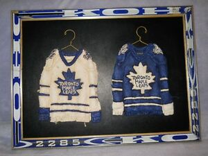 Toronto Maple Leaf sweaters on hangers picture