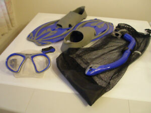 Assortment of swim fins and snorkelling equipment