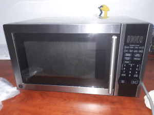 GE 1.1 CUFT STAINLESS STEEL COUNTERTOP MICROWAVE OVEN