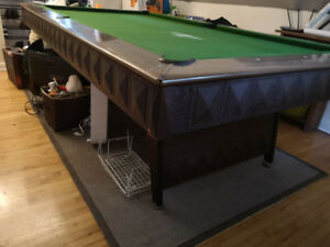 Full size pool table with snooker, pool balls and cues.
