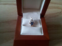 10kt gold pendant with small diamonds and sapphire