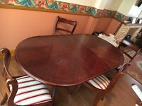 Extending dinning table and four chairs
