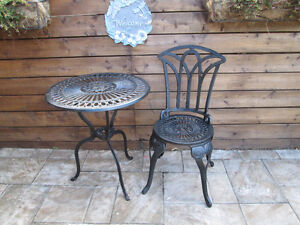 CAST IRON TABLE AND 1 CHAIR