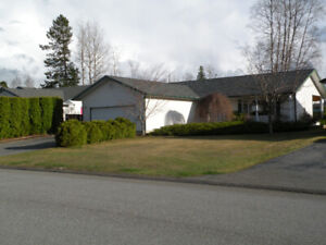 Well maintained rancher style 2 story family home