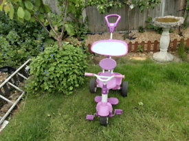 Little tikes 4 in 1 trike with attachments .