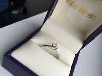 Custom designed white gold solitaire engagement ring