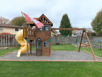 Swing set with two level playhouse and slide