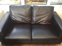 Brown faux leather settee