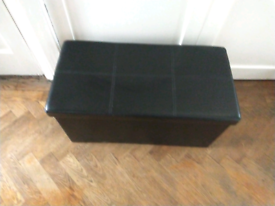 Faux leather storage box with a sit