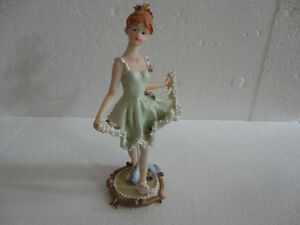 Collectible decorative doll figurine green dress