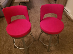Set of two red bar stools. Swiveling. Very comfy!