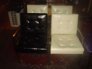4 EXCELLENT LEATHER AND CHROME CHAIRS..(3 WHITE..1 BLACK) -
