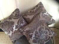 3 grey/silver cushions