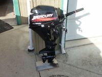 8 HP short shaft outboard, rods, etc.